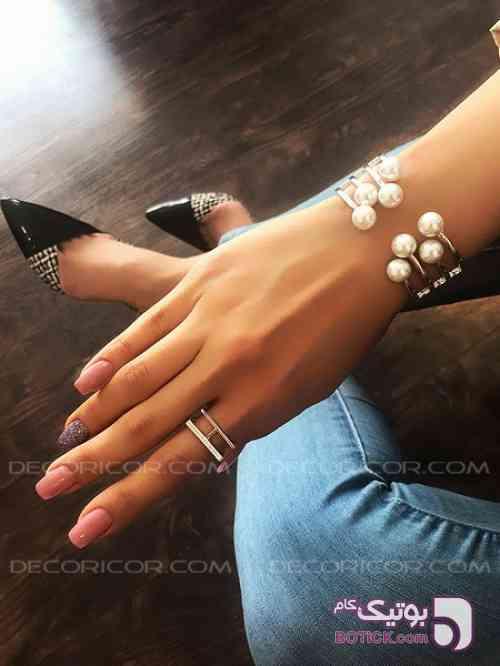 https://botick.com/product/152401-دستبند-لولایی-روکش-طلا-مروارید-دکوریکور
