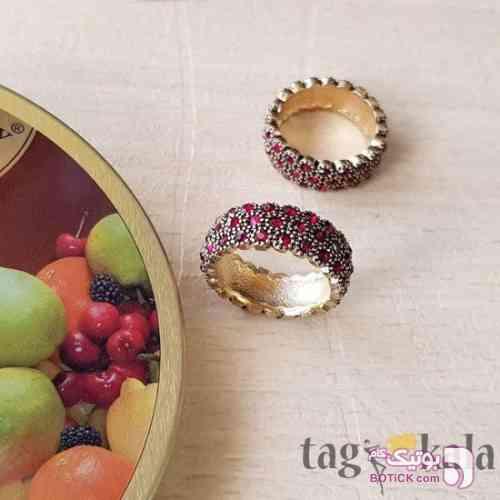 انگشتر استیل با نگین های قرمز طلایی انگشتر