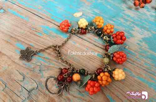 https://botick.com/product/239070-دستبند_تمشک-زرد-نارنجی
