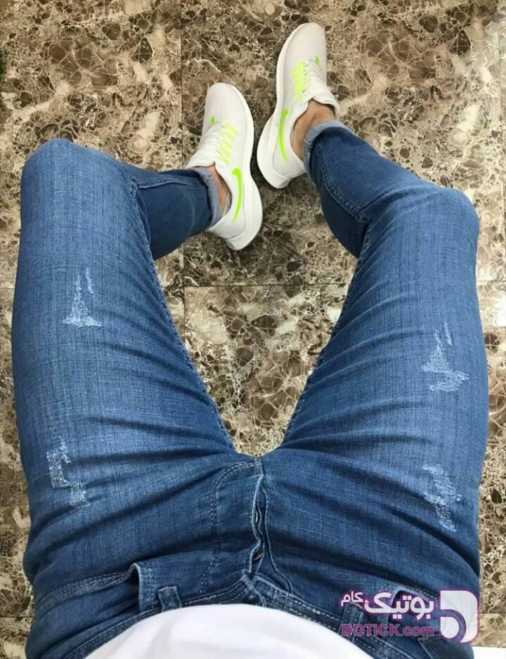 شلوارجین دمپاتنگ تمام کش سورمه ای شلوار جین مردانه