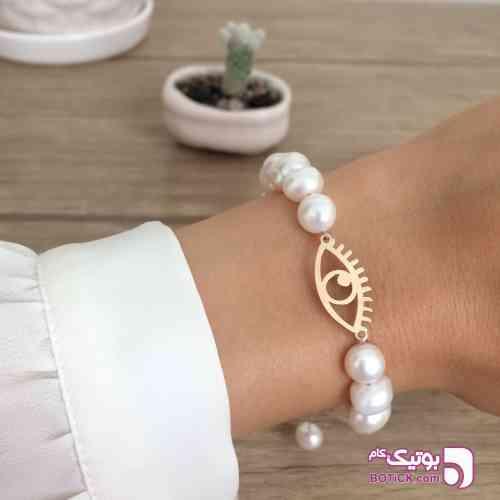 https://botick.com/product/325701-دستبند-طلا-و-مروارید-پرورشی-طرح-چشم