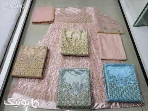https://botick.com/product/402392-لباس-مجلسی-۶۷۸۹