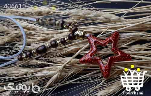 https://botick.com/product/436610-گردنبند-رو-لباسی-ستاره-قرمز