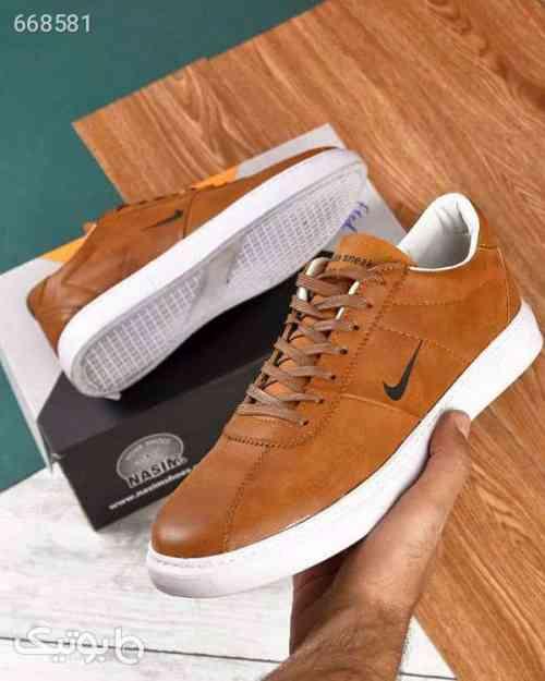 https://botick.com/product/668581-کفش-مردانه-Nike-مدل-Nizzaaکد-۱۴۱۶